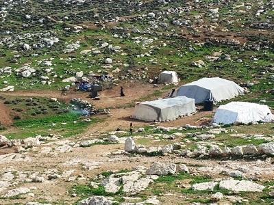 """Zdjęcie ze strony Al Haq z podpisem: """"Izrael demoluje palestyńskie domy""""."""