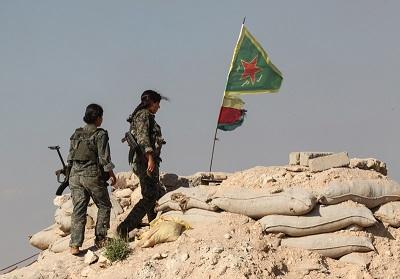 Na zdjęciu: Bojowniczki kurdyjskich Powszechnych Jednostek Obrony (YPG) w pobliżu miasta Kobane w Syrii, 20 czerwca 2015. (Zdjęcie: Ahmet Sik/Getty Images)