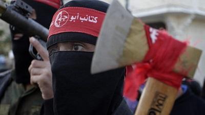 Członkowie Ludowego Frontu Wyzwolenia Palestyny (LFWP) na paradzie wojskowej w Chan Jounis w południowej Strefie Gazy podczas obchodów 47. rocznicy założenia tej grupy, 11 grudnia 2014 r. Zdjęcie: Abed Rahim Khatib/Flash90.