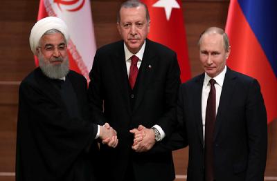 Prezydenci Hassan Rouhani, Tayyip Erdogan Władimir Putin na wspólnej konferencji prasowej w Ankarze 4 kwietnia 2018. (Zdjęcie: UMIT BEKTAS / REUTERS)
