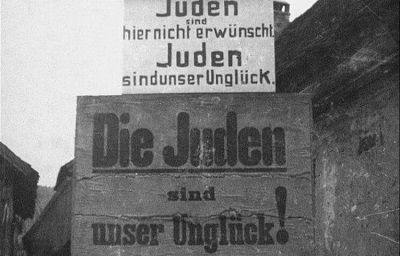 """A sign on a fence """"Jews are not welcome here. The Jews are our misfortune"""" (Germany, around 1935).Source: United States Holocaust Memorial Museum."""