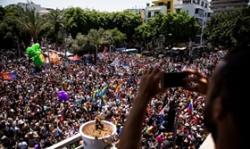 W 2015 roku Izrael zajmował 7. miejsce na pierwszym Indeksie Szczęścia Gejów, badaniu, które mierzyło opinię publiczną, zachowanie społeczne i zadowolenie z życia gejów – mężczyzn w 127 krajach. Na zdjęciu: doroczny marsz LGBT w Tel Awiwie w Izraelu, 8 czerwca 2018 roku. (Zdjęcie: Amir Levy/Getty Images)